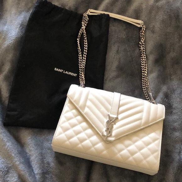 bc0745e032e0b4 Saint Laurent White Medium Envelope Leather Bag. M_5ac41bf5f9e501150227deac